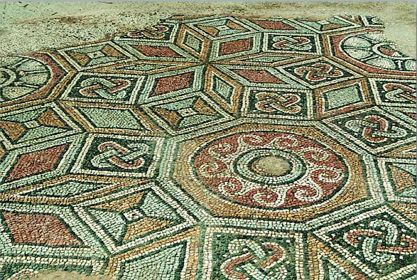 Mosaic floors in the east corridor with stellar designs consisting of 8 lozenges and octagons